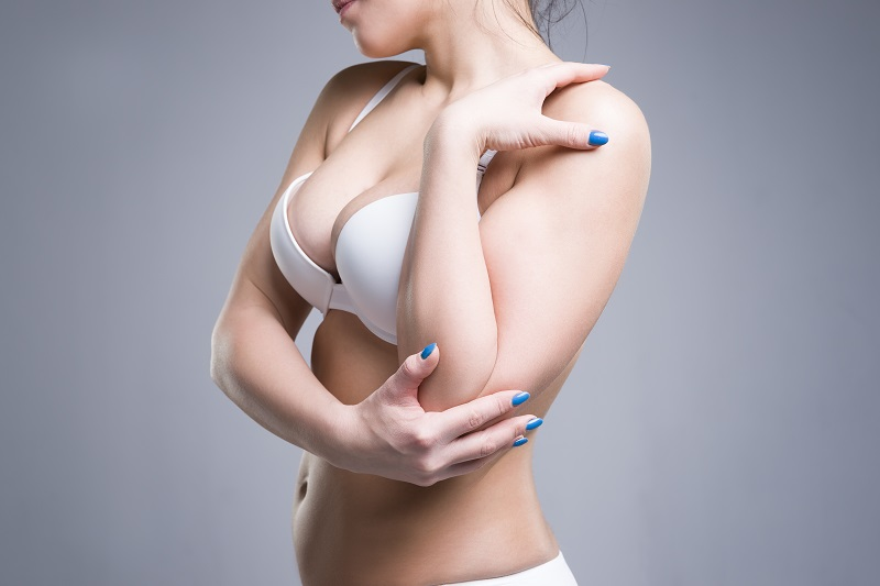 Woman after breast augmentation at Piedmont Plastic Surgery