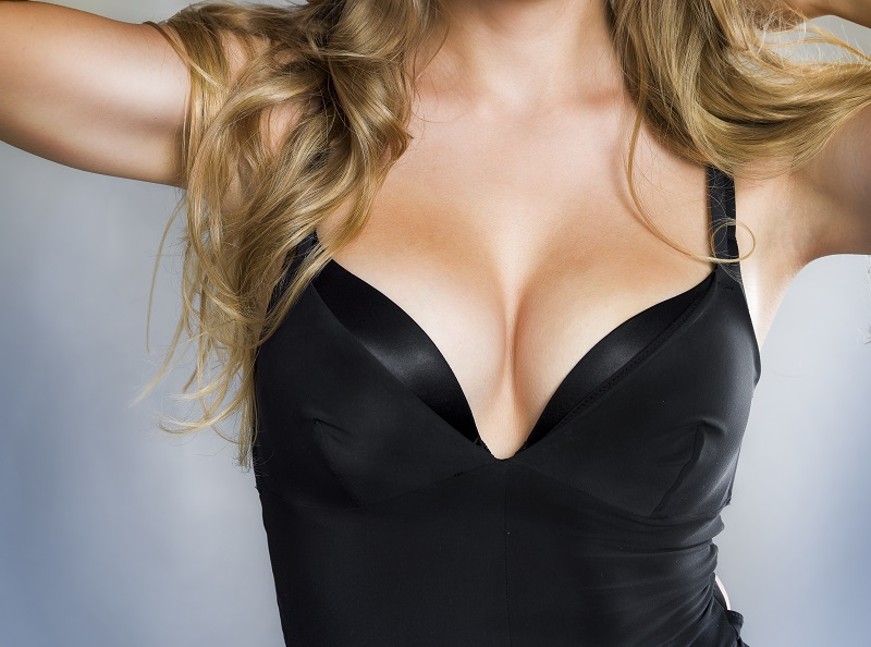 Woman after breast augmentation and lift procedure at Piedmont Plastic Surgery